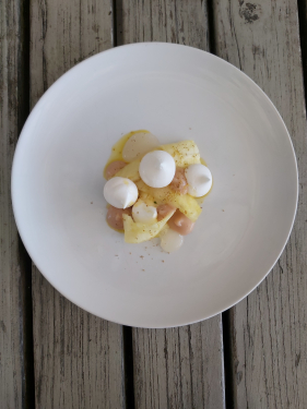Vegan compressed pineapple pavlova, pineapple kombucha, rosehip 'cream', fennel pollen, extra virgin rapeseed oil
