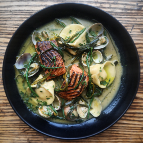 Charred sea trout, smk trout tortellini, clams, cockles, samphire and leeks.