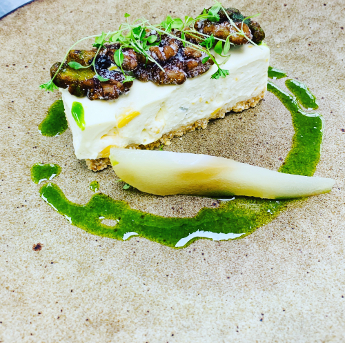 Garstang blue cheese cake , savoury base, candied walnuts, celery oil and cress