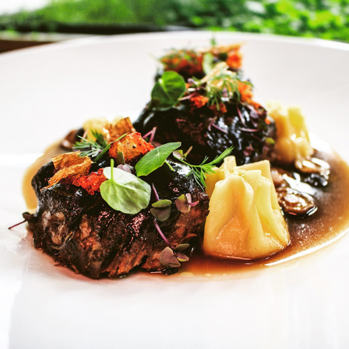 "Braised short ribs, potato+truffle filled pasta, chili+leek+herb ""gremolata"""
