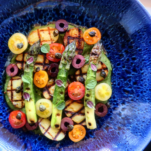 Charred British asparagus and new potatoes, mixed cherry tomatoes, avacado and spinich puree, crispy capers, kalamata olives and rapeseed oil