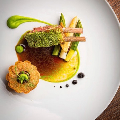 Herdwick lamb rack|lamb fat confit potato|shepherds pie|asparagus|pomme maxim|jus gras Served with a warm pea custard and crispy smoked lamb tongue salad
