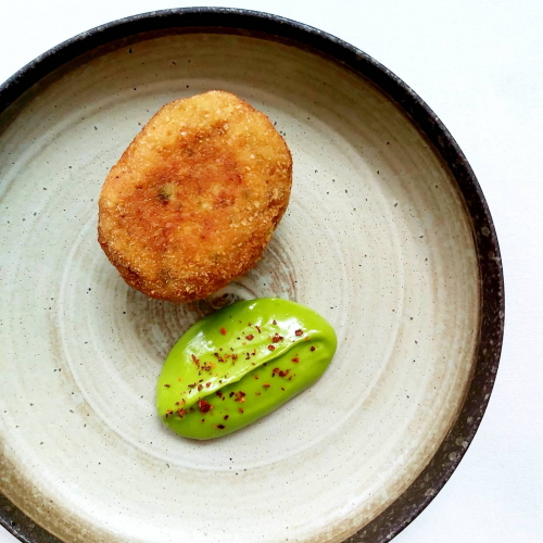 Asian style chicken Scotch egg, coriander mayonnaise, Aleppo pepper. .