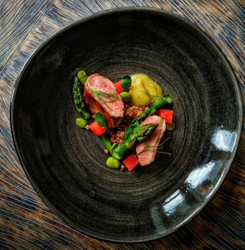 Duck breast, rhubarb and rum puree, buckwheat, compressed watermelon, asparagus.