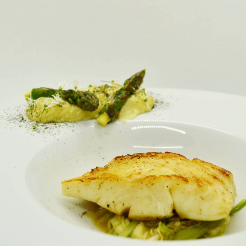 One of my demonstration dishes from today's northern virtual food Festival.  Line caught Halibut, pomme puree, sauteed spring greens, nettle infused consomme and nettle powder