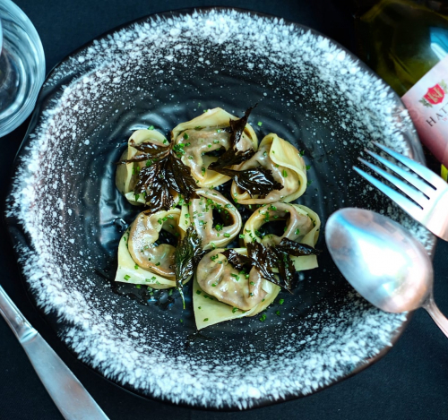 Rendang tortellini , burnt butter chives, & parsley crisp