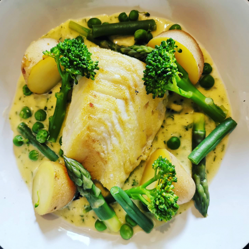 Cod, new potatoes, greens and butter parsley sauce