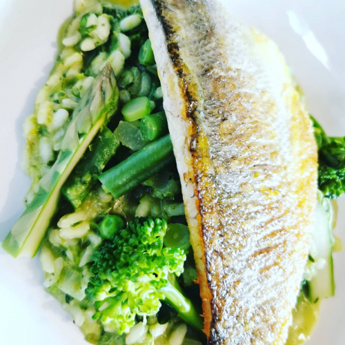 Green veg risotto and pan fried sea bass