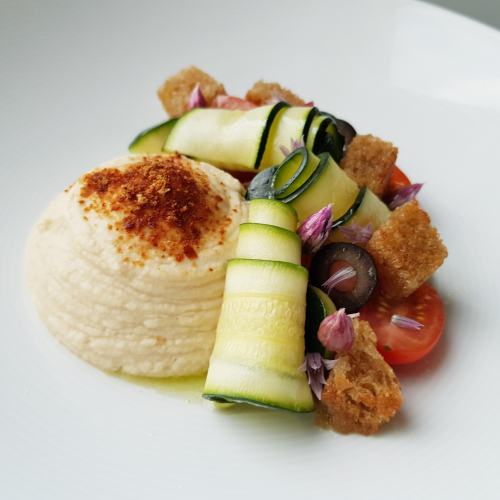 Goats cheese and caramelized onion mousse - panzanella salad - cured courgette - pickled chive buds