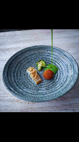 Steamed smoked haddock, haddock croquette, broccoli, pinenut