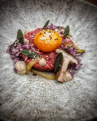 Beef tartare, anchovies, shiitake, powdered truffle oil, sage crisps.