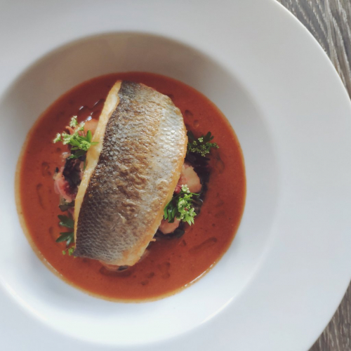 Sea Bass Fillet, Crushed Warm Rooster Potato and Rainbow Chard Salad, Langostine Bisque