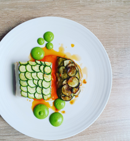 Courgette scaled cod- courgette and pomme anna- romesco- courgette puree- chorizo oil.