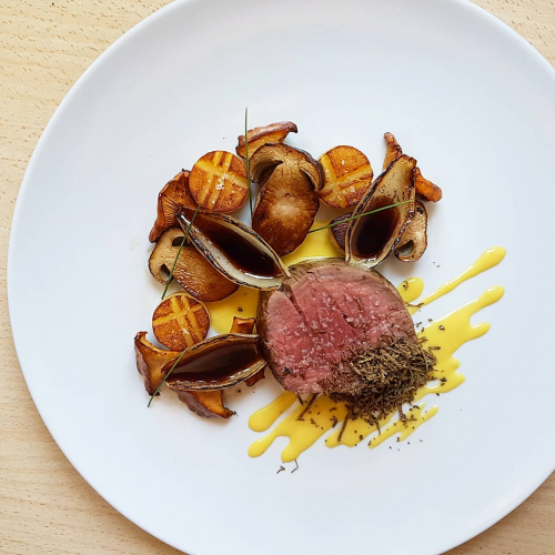 Beef tenderloin•potato fondant•buttered porcini and chanterelles•creamed corn•onion petals•demi glace•black truffle