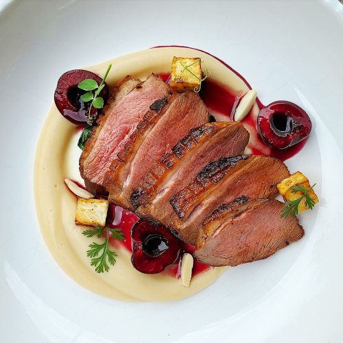 Grilled coffee rubbed duck, roasted celeriac and tiasted oat puree, kale, cherries and almond