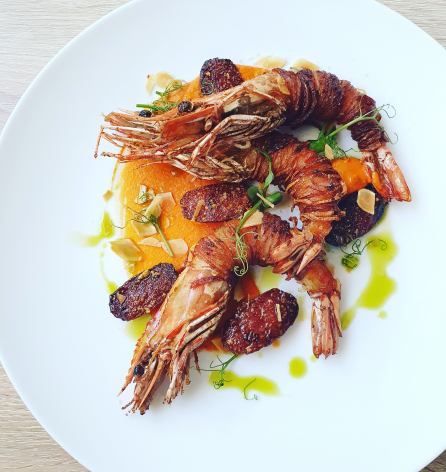 King Prawn wrapped in potato- romesco- roasted chorizo with grated almonds-  lemon and parsely oil.