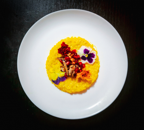Risotto milanese with cranberry, porcini, hazelnut