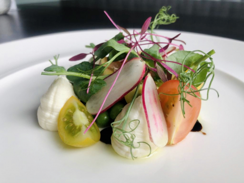 Whipped goats cheese, dressed peas, tomato, radish and micro cress salad