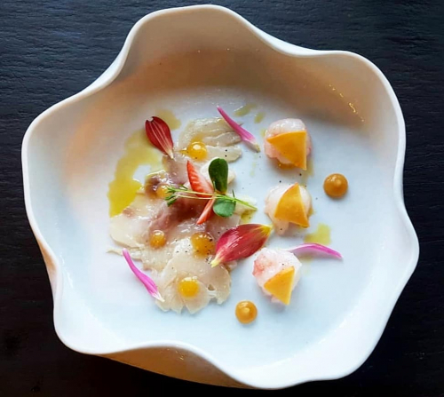 Sea bass carpaccio,langoustine marinated in citrus emulsion,peach puree,orange gel,olive oil...