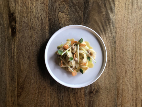 Hay and salt baked celeriac • celeriac pasta • celeriac juice • celeriac crisps • celeriac and black garlic purée • apple matchsticks and rosemary oil.