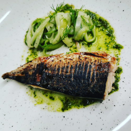 Yakatori glazed and charred mackeral with pickled cucumber dill and salsa verde
