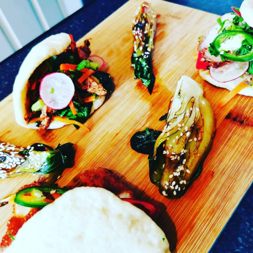 Trio of steamed bao buns char Sui pork, chicken and crispy haloumi served with charred pak choi soy and sesame