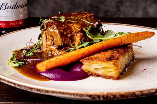 """Lamb hot pot"" Braised lamb shoulder - pomme anna- stock pot carrot- red cabbage purée- red wine jus"