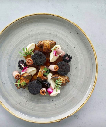 Duck black pudding,  duck pastrami,  ceps, smoked cauliflower puree , blackberry jus...