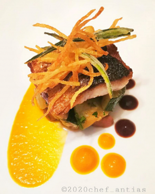 "Pan seared Flat head Grey Mullet, ""Lunga di Napoli"" Squash Puree, courgette and ham ragout, octopus jus, crispy potato and zucchinis Julienne."