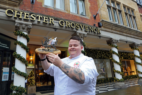 National Chef of Wales winner Sam Griffiths celebrates with the trophy outside the Chester Grosvenor