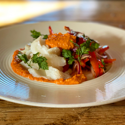 Salt cod, red pepper & calcot slaw, Romesco sauce