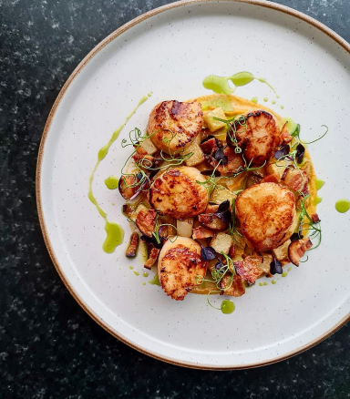 Pan seared scallops- devilled corn puree- sautee potatoes- crispy pancetta- lemon n parsely dressing.