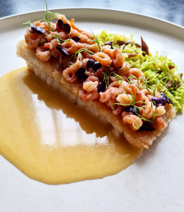 Skate wing- baby shrimps- sauteed savoy cabbage with duck ham- skate butter sauce.
