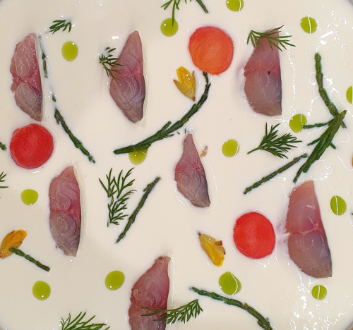 Citrus and sechuan button cured mackerel, buzz button pickled gorse and samphire, lacto fermented tomato, buttermilk and electric herb oil