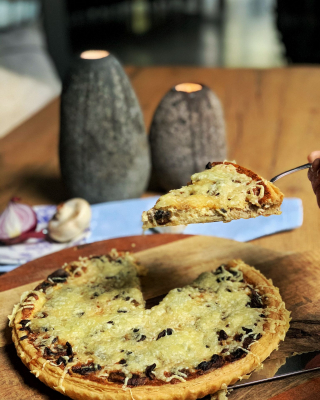 Quiche with mushrooms and selery,  onions and cheese