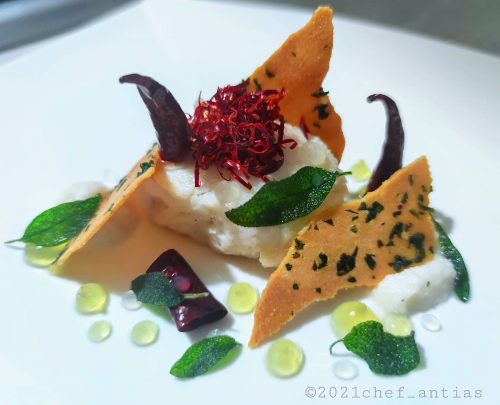 "Buttermilk poached Cod fillet, ""Crusco"" Peppers, lemon and sage gel, wild garlic cracker, light soy bubbly sauce."