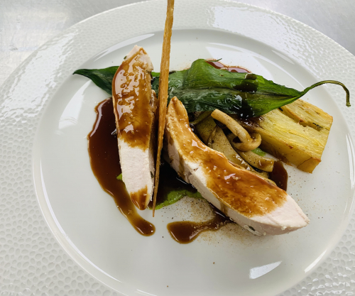 Poached chicken breast , crispy chicken skin, wild garlic purée, wild garlic crisp , pomme Anna potato, wild mushrooms, wild mushroom powder, chicken jus