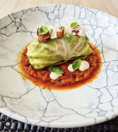 "Pork and smoked scarmoza stuffed cabbage roll- toasted walnut puree- pancetta- ""Fermented tomato"" sauce amatriciana."