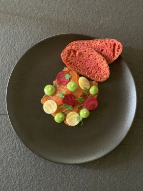 Elderflower and lemon cured trout, loveage emulsion, pickled beetroot, beetroot bread