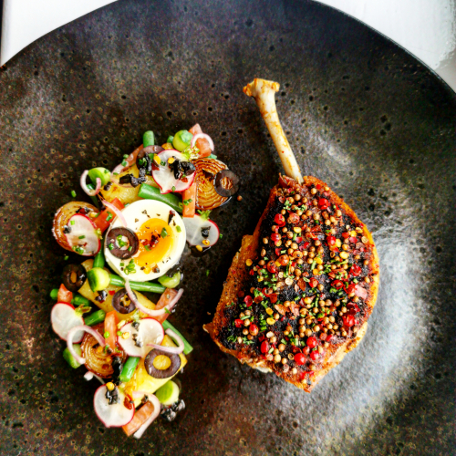 Confit duck leg  with toasted seeds and pink pepper, Nicoise salad with a tomato oil, chilli and black olive dressing
