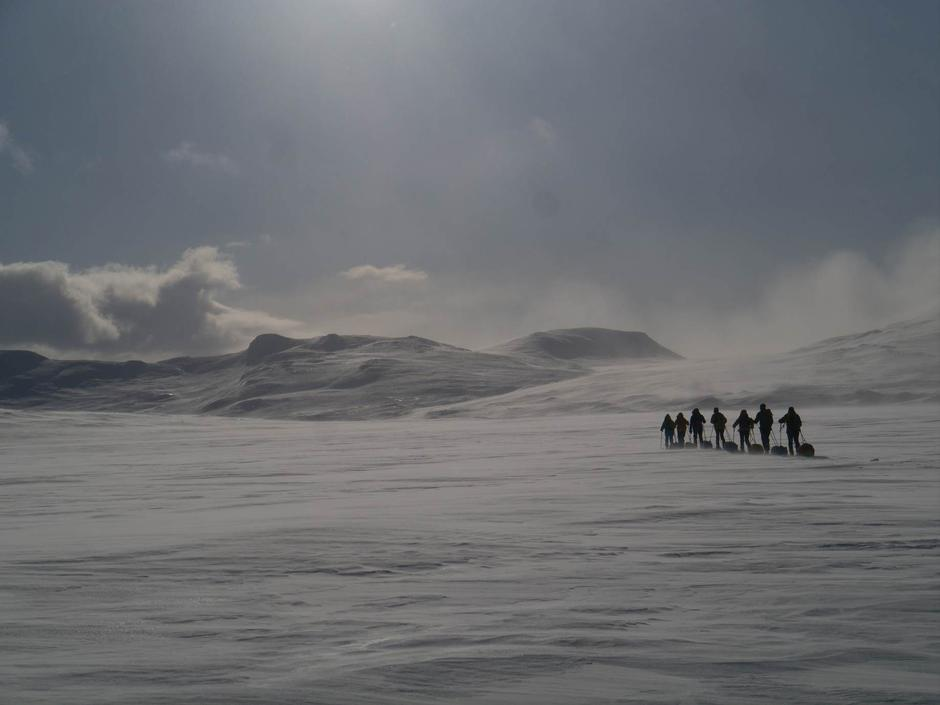 A group of skiing tourists on their way from Vuoma to Dividalen.