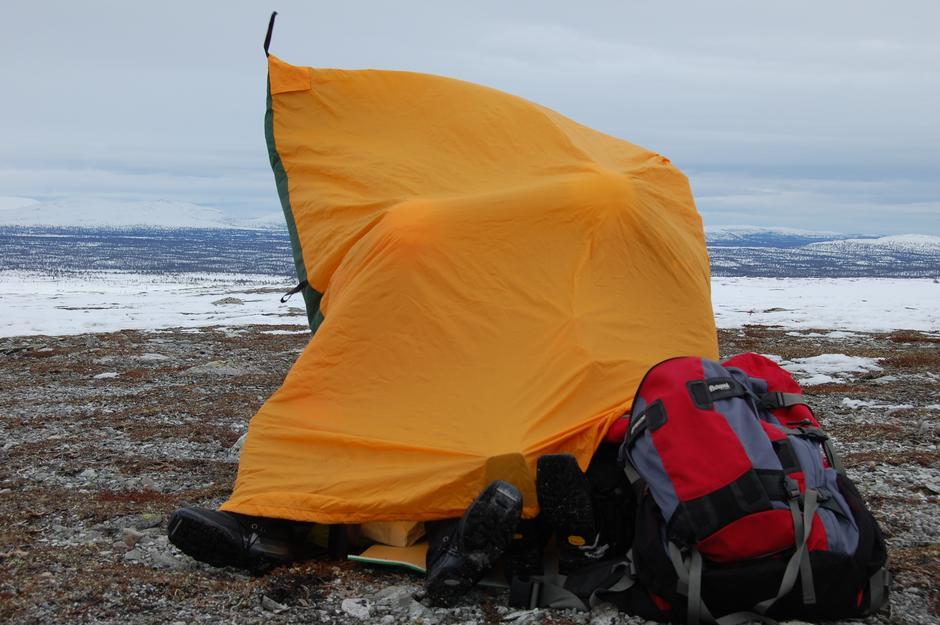 Vindsekken gir god ly for vær og vind, og bør være obligatorisk utstyr for vinterturer i høyfjellet.
