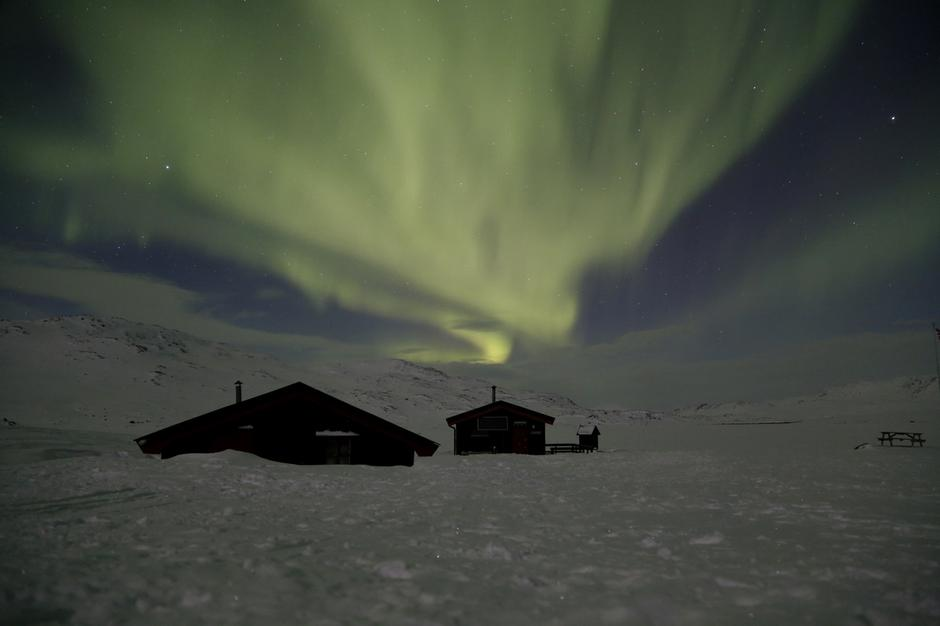 Cunojavrihytta in winter with northen light (Aurora Borealis)