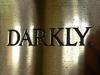 darkly