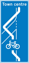 Route for pedal cycles across an entry slip road at a junction ahead