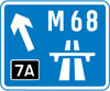 Direction to a motorway at the junction shown, indicating route number