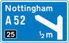 Motorway junction ahead, displaying the route number and destination reached by taking this route