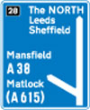 Motorway junction, displaying route number and destination reached as well as destination reached by remaining on the motorway