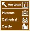 Motorway junction ahead leading to a town or geographical area containing several tourist attractions and a Tourist Information Point or Centre