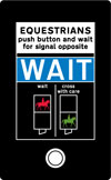 Instructions to horse riders above the push button control for an equestrian traffic crossing